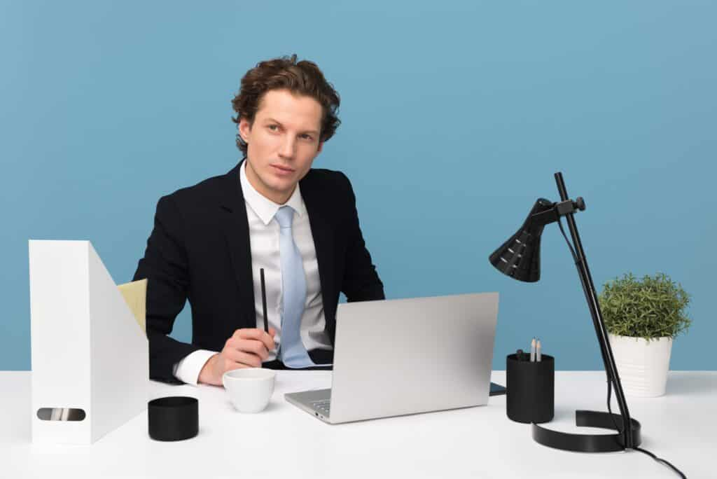 man poised for virtual job interview | how to create a eye-catching video for your next video | Eat. Drink. Work. Play.