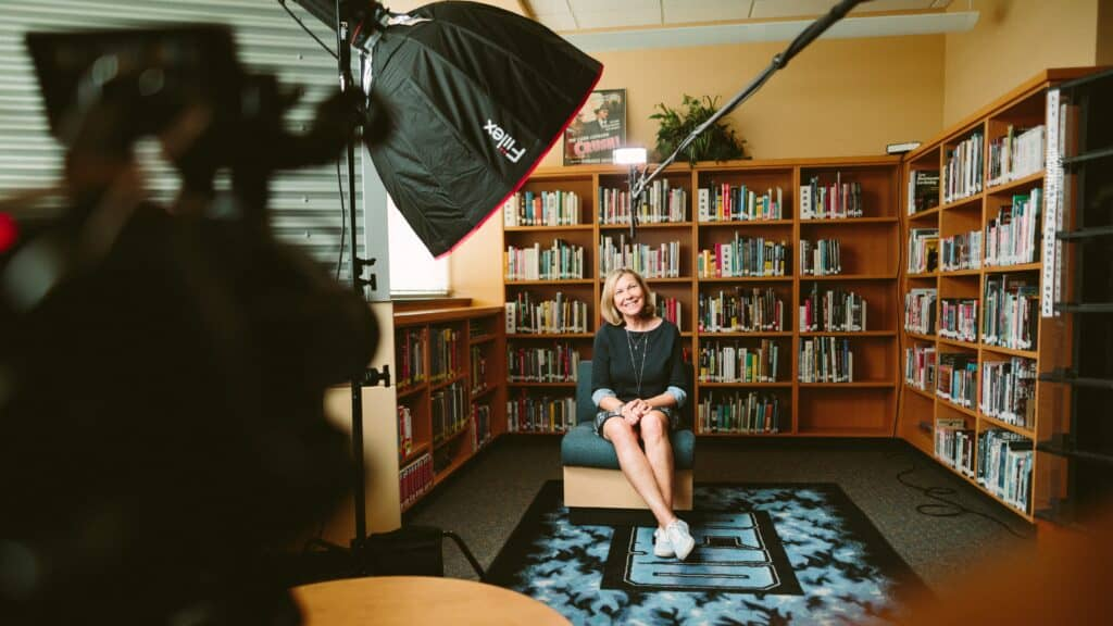 woman sitting for photo and interview | how to create an eye-catching personal video for your next interview | Eat. Drink. Work. Play.